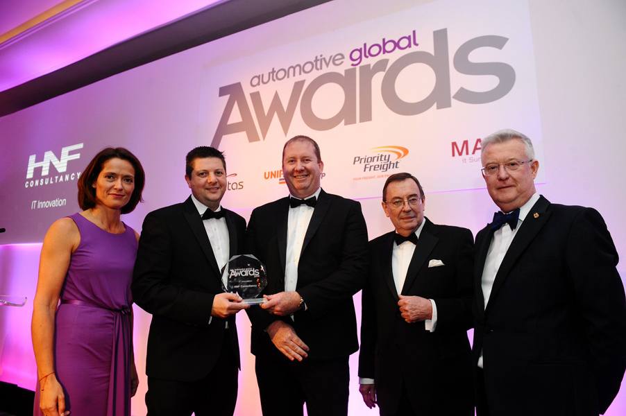 HNF receiving Automotive Global award.